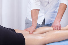 Leg massage in hospital Royalty Free Stock Images