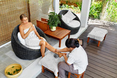 Leg Massage Spa Therapy. Body Care. Masseur Massaging Female Leg Royalty Free Stock Images