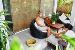Leg Massage Spa Therapy. Body Care. Masseur Massaging Female Leg Stock Image