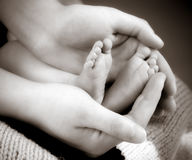 Leg newborn little baby in the mother's hands Royalty Free Stock Images