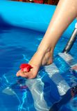 Leg in pool Royalty Free Stock Photography