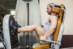 Leg press. A handsome young muscular sports man doing leg press Royalty Free Stock Photo
