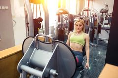 Leg press exercise. In gym royalty free stock photography
