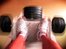 Leg press movement Stock Images