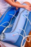 Leg pressotherapy Stock Photo