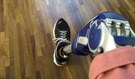 Leg prosthesis and tennis shorts. Prosthetic leg blue mechanics, advanced technology with shoes and shorts stock image