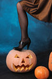 Leg on pumpkin Royalty Free Stock Image
