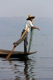 Leg-rowing fisherman at Inle Lake, Myanmar. The photo shows a leg-rowing fisherman at Inle Lake, a famous tourist destination in Myanmar. Leg-rowing with one leg Royalty Free Stock Photography