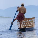 Leg Rowing Fisherman - Inle Lake - Myanmar. A leg rowing fishermen on Inle Lake in Shan State in Myanmar (Burma).This unique style of rowing evolved because the Royalty Free Stock Image