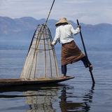 Leg Rowing Fishermen - Inle Lake - Myanmar (Burma). A leg rowing fisherman on Inle Lake in Shan State in Myanmar (Burma).This unique style of rowing evolved Stock Photography