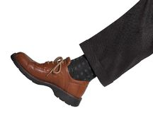 Leg and shoe. Detail of a dark vested male leg with brown shoe Royalty Free Stock Photos