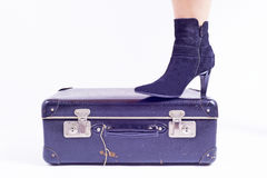 Leg and shoe on old suitcase Royalty Free Stock Image