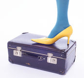 Leg and shoe on old suitcase Royalty Free Stock Images