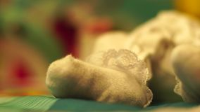 Leg of a small newborn baby. The leg of a small newborn baby stock footage