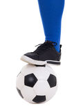 Leg of soccer player in blue gaiter with ball isolated on white Stock Photos