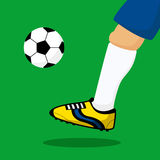 Leg of soccer player. Royalty Free Stock Photography