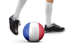 Leg of soccer player kicking a ball Royalty Free Stock Photography