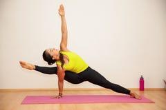 Leg split in a yoga studio Stock Images