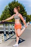 Leg stretch at railing Royalty Free Stock Image