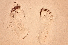 Leg traces on sand footprint  the yellow small beach paradise rest Royalty Free Stock Photos