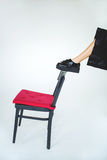 Leg in trendy brogue on chair over isolated background Royalty Free Stock Image