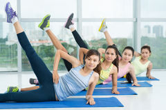 Leg up exercise Stock Images
