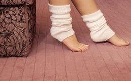 Leg warmers. Woman wearing white leg warmers stock images