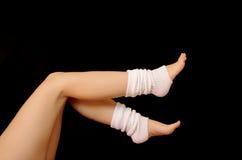 Leg warmers. Woman wearing white leg warmers royalty free stock photography