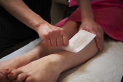 Leg waxing Royalty Free Stock Photo