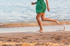 Leg of woman running on sand beach. summer vacation. Happy beautiful woman running on the beach stock photography