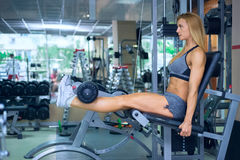 Leg workout at gym Stock Image