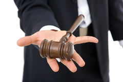 Legal. Concept with businessman holding a gavel on white Stock Images