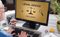Legal advice concept on a computer. Man using a computer with legal advice concept on the screen Royalty Free Stock Photos