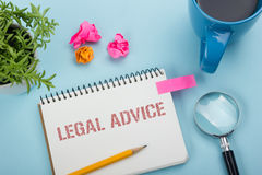 Legal Advice. Notepad with message, coffee cup, pen and flower. Office supplies on desk table top view Stock Image