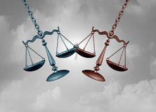 Legal Battle And Lawsuit. Legal battle lawsuit concept as two justice scales hitting each other as a justice court fight symbol representing a lawyer or attorney Stock Image