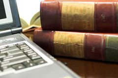 Legal books #29. Laptop and Legal books on table - South African Law Reports - Shallow DOF Royalty Free Stock Image