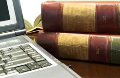 Legal books #30. Laptop and Legal books on table - South African Law Reports Royalty Free Stock Photography