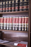 Legal books in lawyers office. Old legal books law reports on shelves of law offices of attorneys and lawyers in judicial reference library Royalty Free Stock Photos