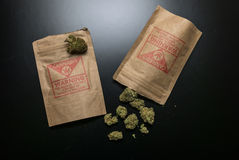 Legal Cannabis Flowers and Packages Stock Photo