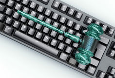 Legal computer judge concept, cyber gavel on computer keyboard Royalty Free Stock Photo