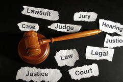 Legal concepts. Judge's gavel and legal terms from newspaper headlines Royalty Free Stock Photo