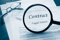 Legal contract. With magnifying glass and glasses Stock Images