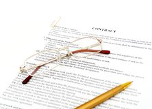 Legal contract papers. With pen and glasses royalty free stock photo
