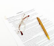 Legal contract with pen and glasses Royalty Free Stock Photography