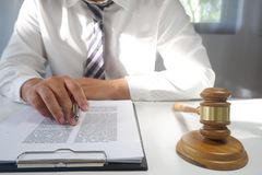 Legal counsel presents a contract with gavel and legal law. Justice and lawyer concept. Legal counsel presents a contract with gavel and legal law on desk. for stock image
