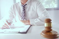 Legal counsel presents a contract with gavel and legal law. Justice and lawyer concept.  stock images