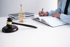 Legal counsel presents to the client a signed contract with gave. L and legal law. justice and lawyer concept stock images