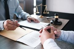 Legal counsel presents to the client a signed contract with gave. L and legal law. justice and lawyer concept stock photography