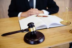 Legal counsel presents to the client a signed contract with gave. L and legal law. justice and lawyer concept stock photos