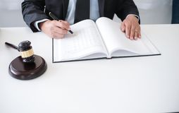 Legal counsel presents to the client a signed contract with gave. L and legal law. justice and lawyer concept stock photo